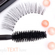 Black false eyelashes with mascara and powder, on white backgrou - Stock Photo