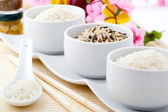 Porcelain bowls of uncooked rice — Stock Photo