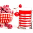 Glass juice with chinese cherry apples with frozen raspberries, — Stock Photo