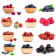 Set of fresh strawberry, Blueberries, Raspberries, cherry, gooseberries and blackcurrants in a wooden bowl, over a white background. — Stock Photo #22082787