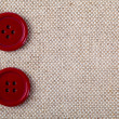 Red buttons on the old clothes — Stock Photo
