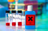 Dangerous substance in a plastic container on laboratory table — Stock Photo
