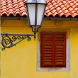Old street-lamp on house window - Stock Photo