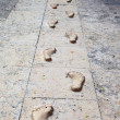 Optical illusion footprints with shadows — Stock Photo #22696129