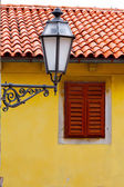 Old street-lamp on house window — Stock Photo
