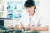 Girl debugging an electronic precision device — Stock Photo