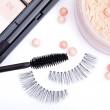 ������, ������: Black false eyelashes with mascara and powder on white backgrou