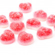 Red fruit candies in heart formation, isolated on white - Stock Photo