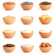 Assortment of nuts and grits in the wooden bowl. — Stock Photo