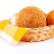Fresh baked buns in a basket on white background - Stock Photo