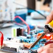 Repaired by soldering a PC board - Stock Photo