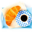 Breakfast with cup of black coffee and croissants  — Stock Photo
