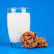 Stock Photo: Glass of milk with chocolate cookies