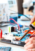 Repaired by soldering a PC board — Stock Photo