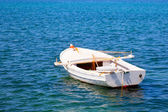 Boat in water. Old wooden boat — Stock Photo