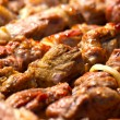 Macro shot of shashlik on skewers - Stock Photo
