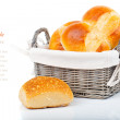 Royalty-Free Stock Photo: Baked bread bun in basket. isolated on white