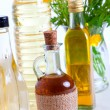 Stock Photo: Bottles of oil with buttercup