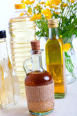 Bottles of oil with buttercup — Stock Photo