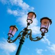 Old street-lamp on blue sky — Stock Photo