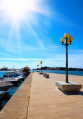 Berth with street-lamp on sea background. Pula Croatia — Stock Photo