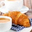 Croissant with marmalade and caffee cup. on wooden backgroun — Stock Photo #27462653