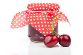 Cherry jam jar isolated on white — Stock Photo