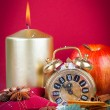 Christmas decorations - clock for the new year, candle, pine bra — Stock Photo