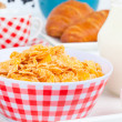 Cornflakes in a porcelain bowl on tabl — Stock Photo