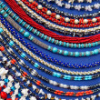 lot of colored beads from different minerals and stone blue back — Stock Photo