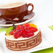 Low-calorie fruit cake with cup caffee, on white background — Stock Photo