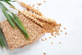 Crispbread with ears and wheat grain, isolated on a white backgr — Stock Photo