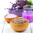 Dry Lavender herbs, bath salt and candle, on white wooden table — Stock Photo