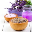 Dry Lavender herbs, bath salt and candle, on white wooden table — Stock Photo #29996641