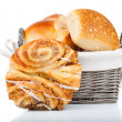 Baked bread bun in basket. isolated on white — Stock Photo #29997805