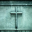 Stock Photo: Cross on wall background