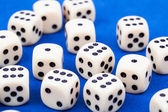 Dice rolling on blue background — Stock Photo