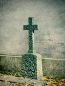 Cross on tombstone grunge wall background — Stock Photo