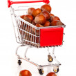 A Shopping cart full of hazelnut, on a white background — Stock Photo