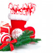Santa's boot and Xmas candy, isolated over white — Stock Photo