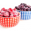 Stock Photo: Frozen raspberries and bilberries in the bowl, on a white backgr