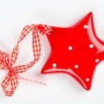 Christmas star ornament of porcelain, on white backgroun — Stock Photo #31704319