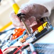 Soldering electronic parts on a printed circuit board — Stock Photo