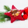 Stock Photo: Bright christmas composition with red stars and red Christmas ba