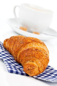 Croissant with caffee cup. Isolated on white backgroun — Stock Photo