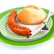 Stack of cooked sausages on a plate with bun — Stock Photo #33175953