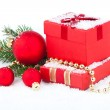 Christmas red gift with festive decorations on snow background — Stock Photo