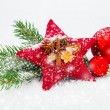 Bright christmas composition with red stars and red Christmas ba — Stock Photo