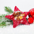 Bright christmas composition with red stars and red Christmas ba — Stock Photo #33177195