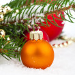 Christmas balls and fir branches with decorations — Stock Photo